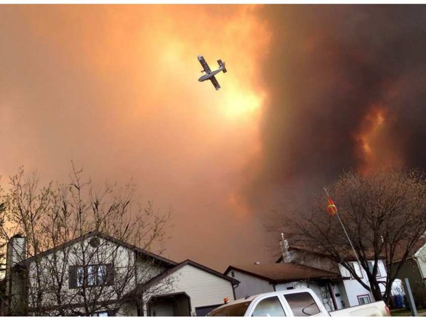 smoke-fills-the-air-as-a-small-plane-flies-overhead-in-fort